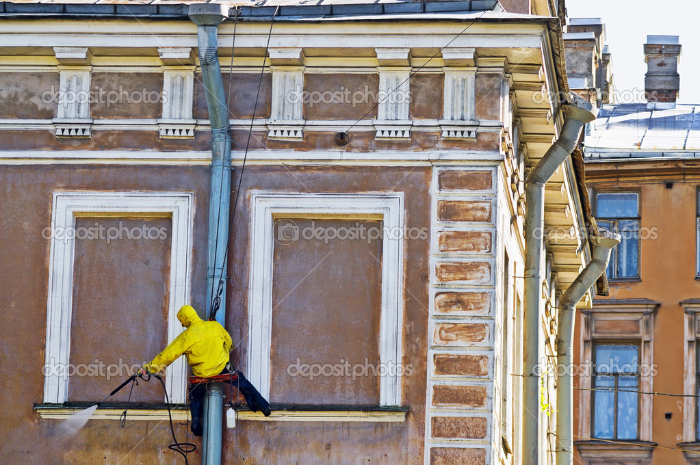 Cleaning service worker washing old building facade — Stock Photo #2982164