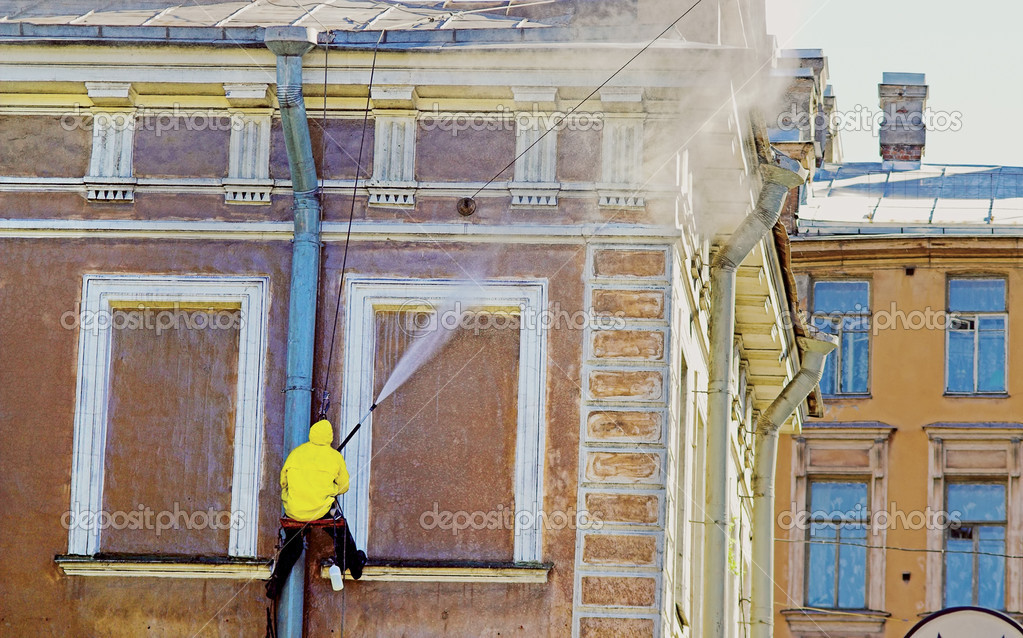 Cleaning service worker washing old building facade — Stock Photo #3070074