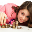A woman touching stacks of coins — Stock Photo