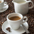 Espresso and coffee beans - Stockfoto