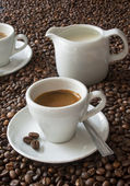 Espresso and coffee beans — Stock Photo