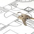 Foto Stock: House key on a blueprint