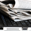 Newspapers on the laptop — Stock Photo