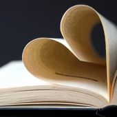 Pages of a book curved into a heart — Stock Photo