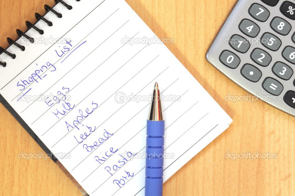 Shopping list with pen and calculator on brown desk  Stock Photo #3623999