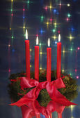 Red candles on christmas wreath — Stock Photo