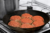 Frying meat rissoles — Stock Photo