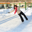 Girl on winter skate rink — Stock Photo