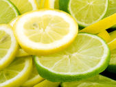 Lemon and lime slices — Stock Photo