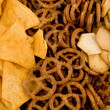 Tortilla chips, pretzels and crackers — Stock Photo