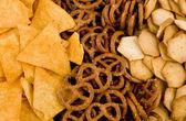 Tortilla chips, pretzels and crackers — Stock Photo