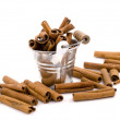 Stock Photo: Aromatic cinnamon in small bucket