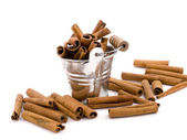 Aromatic cinnamon in small bucket — Stock Photo