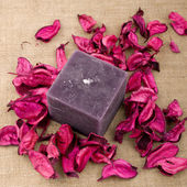 Pink potpourri and purple candle — Stock Photo