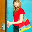 Girl opens door — Stock Photo #2956323