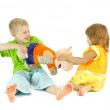 Stock Photo: Children divide toy