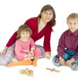 The woman plays with children — Stock Photo