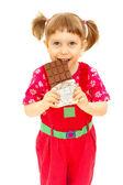 The babe eats chocolate — Stock Photo