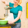 The girl uses a meat grinder — Stock Photo