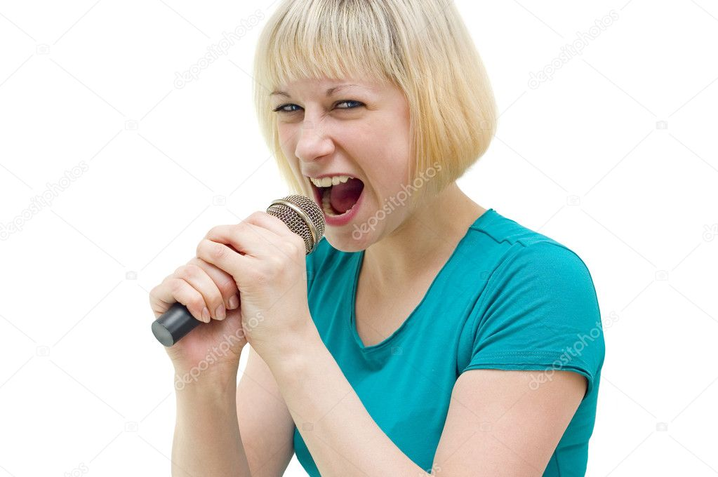 Emotional girl with a microphone in his hands — Stock Photo #3173291