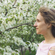 Girl with a flowering tree — Stock Photo