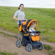 Mother takes baby in a stroller — Stock Photo #3386460