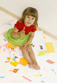 Girl cut colored paper — Stock Photo