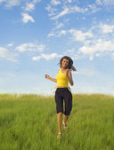 Girl runs across the grass — Stock Photo