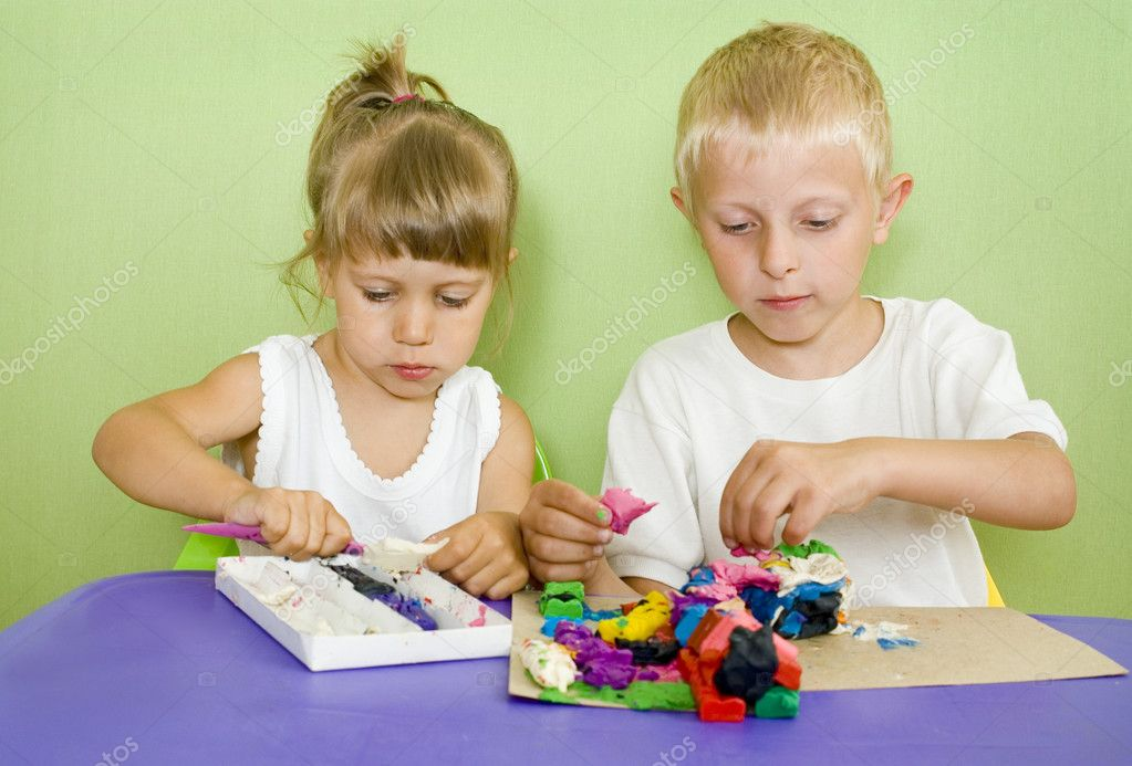 Kids passionate about modeling from clay  Stock Photo #3530510