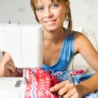 She sews — Stock Photo