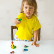 The girl with plasticine — Stock Photo #3642524