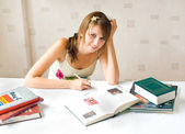 The girl with the books — Stock Photo