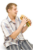 A young man with a big sandwich — Stock Photo
