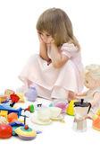 The sad girl among toys — Stock Photo