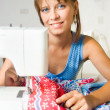 Royalty-Free Stock Photo: The girl sews