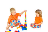 Two children build a tower — Stock Photo