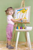 Baby paints at the easel — Stock Photo