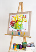 Easel and paints — Stock Photo
