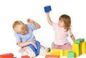 Girl beats boy toy — Stock Photo