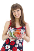 The girl with vegetables in hands — Stock Photo
