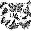 A set of black and white butterflies — Imagen vectorial