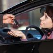 Young woman receiving the car keys from car salesman - Stock Photo