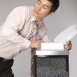 Stock Photo: Young caucasibusinessmshredding documents