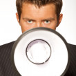 Portrait of businessman with megaphone — Stock Photo