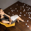 Businesswomthrowing crumpled paper on floor — Stock Photo #3809423