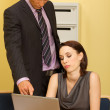 Businesswoman and businessman at work — Stock Photo