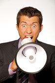 Businessman shouting through megaphone — Stock Photo