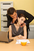 Businessman flirting with businesswoman in office — Stock Photo