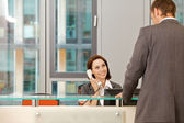 Young caucassian secretary assisting businessman — Stock Photo