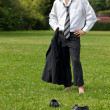 Portrait of businessman in contemplation standing in park — Stock Photo